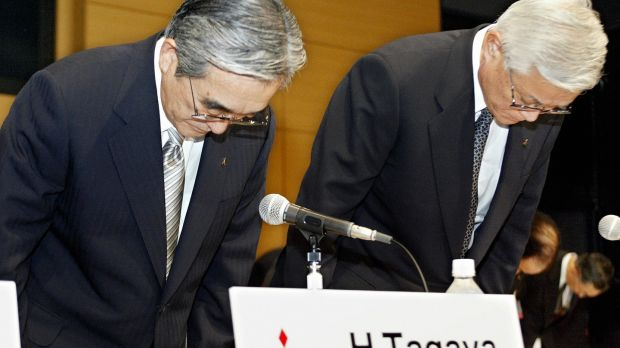 Chairman and CEO of Mitsubishi Motors Yoichiro Okazaki (R) and president and COO Hideyasu Tagaya (L) bow to offer their apology for victims of defects of Mitsubishi's vehicles during a press conference after their annual shareholders' meeting at the headquarters in Tokyo, Jun,e 2004. Photograph: Toru Yamanaka/AFP/Getty Images