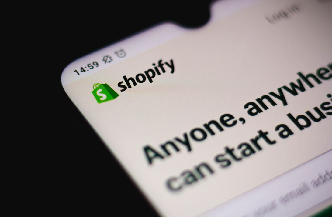 Shopify logo on a phone screen