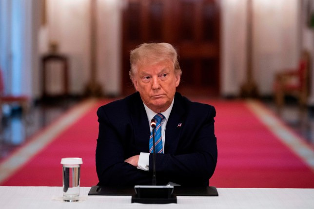 US President Donald Trump sits with his arms crossed during a roundtable discussion on the Safe Reopening of Americas Schools during the coronavirus pandemic