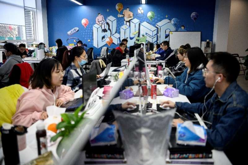Blued parent company BlueCity's sunlit Beijing campus teems with young programmers who hold meetings in rooms named after Oscar