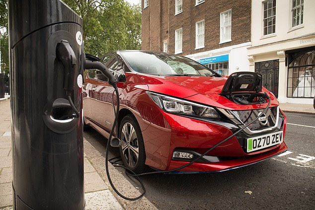But the Climate Change Committee says that to meet 'ambitious' plans to cut emissions by 68 per cent from 1990 levels by then, 46 per cent of the UK 'car fleet' must already have electric motors.