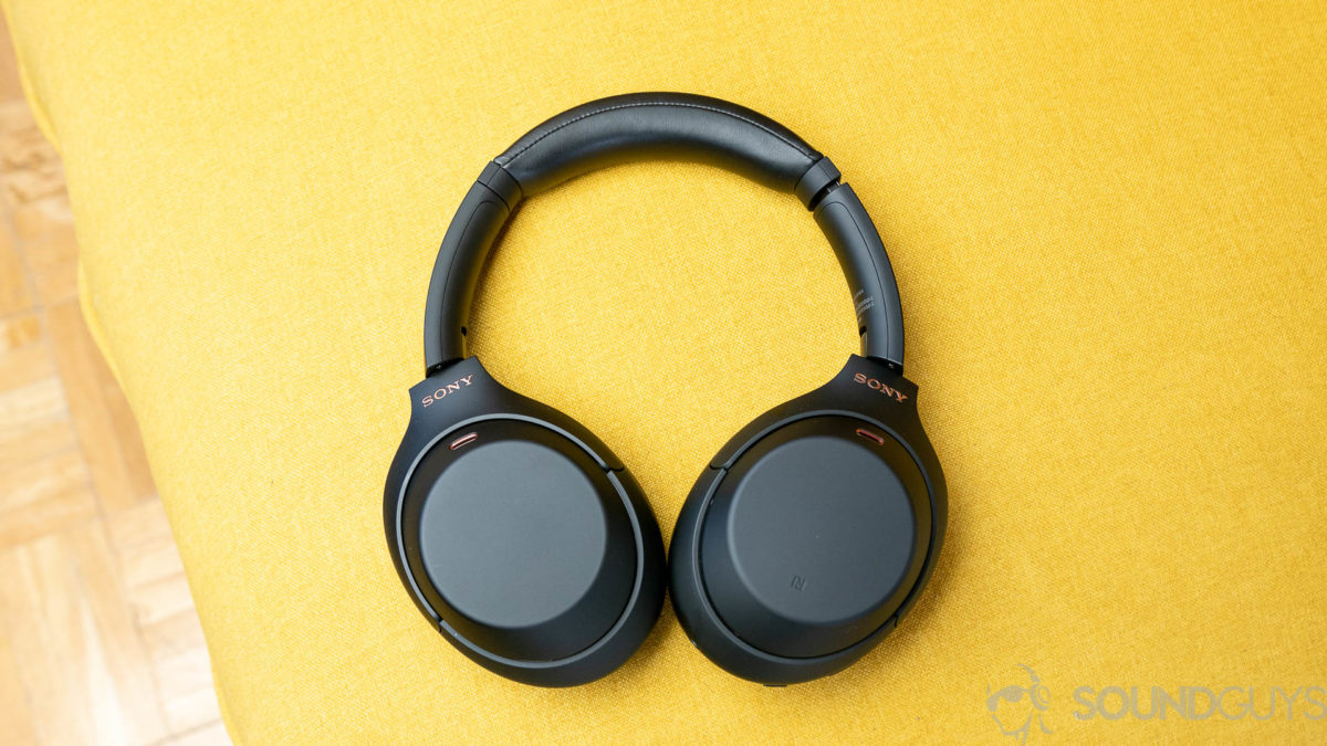 The Sony WH-1000XM4 noise cancelling headphones full yellow backdrop.