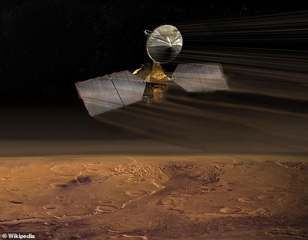 NASA's Mars Reconnaissance Orbiter arrived at the Red Planet in 2006 and recorded the 'happy face' in 2011, using its powerful High-Resolution Imaging Science Experiment (HiRISE) camera