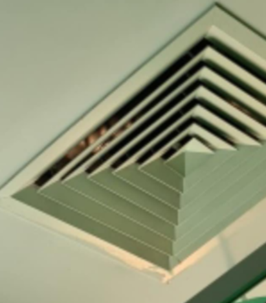 The second is zoomed in on the vent and appears to show a ghostly pair of eyes.
