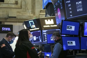 Traders on the floor of the New York Stock Exchange last night