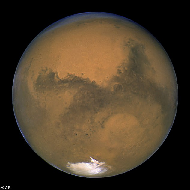 Mars (pictured) is moving steadily to the west and you can usually recognise it by its distinctive colour, as well as its distinct lack of twinkling. Tonight it's set to appear next to the Moon as a small dot and can be viewed without a telescope