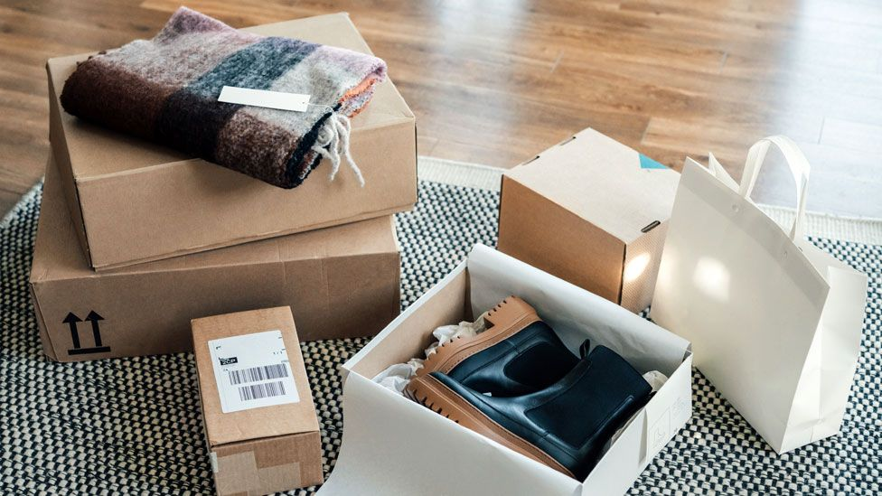 A stock image of a pile of delivered packages