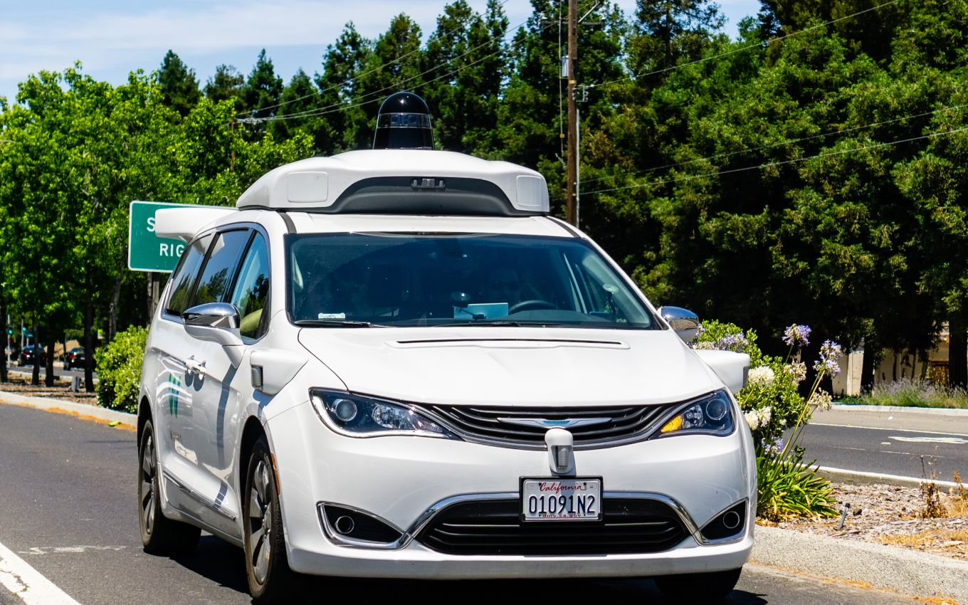 Google's self-driving Waymo car with a LiDAR unit on its roof
