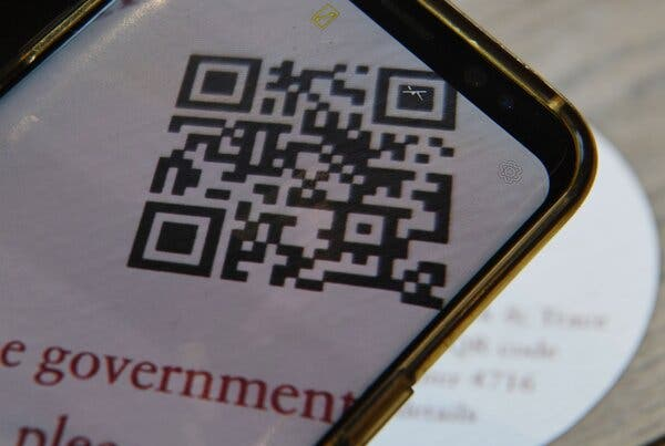 A QR code in a London cafe, for use with the British government's contact tracing app.