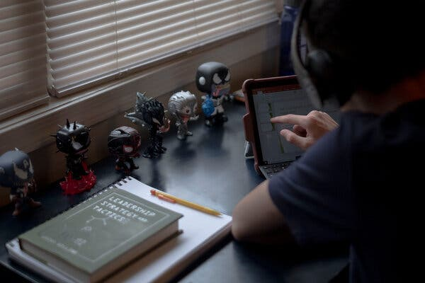 Eyan Gallegos, 11, a middle schooler in Washington, completing his homework in his room.