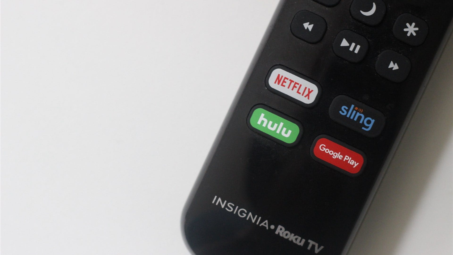 A picture of a Roku remote with a Google Play button