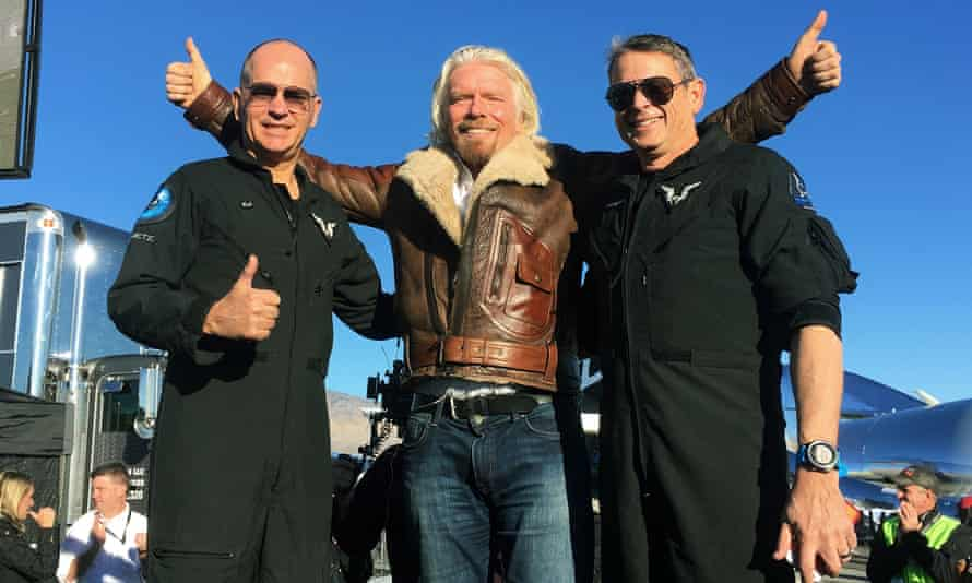 High point: Branson with pilots Rick Sturckow and Mark Stucky after Virgin Galactic's tourism spaceship climbed more than 50 miles high above California's Mojave Desert on 13 December 2018.