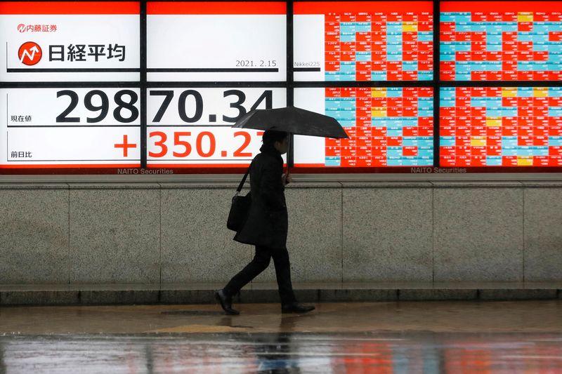 Stocks rally as investors eye economic rebound, gold gains