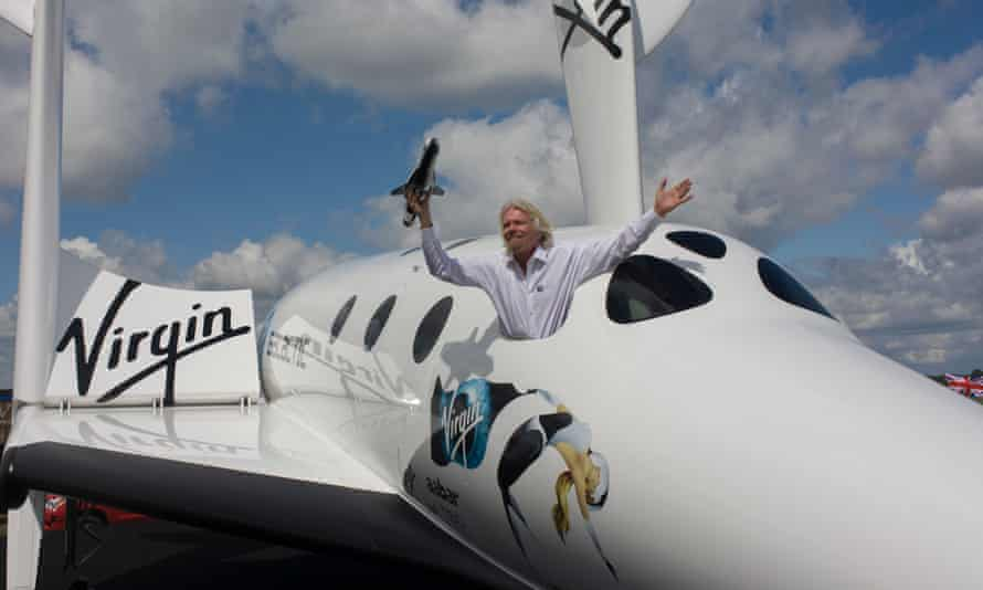 Lofty ambitions: Richard Branson holds a model of LauncherOne in 2012 at the Farnborough Air Show.