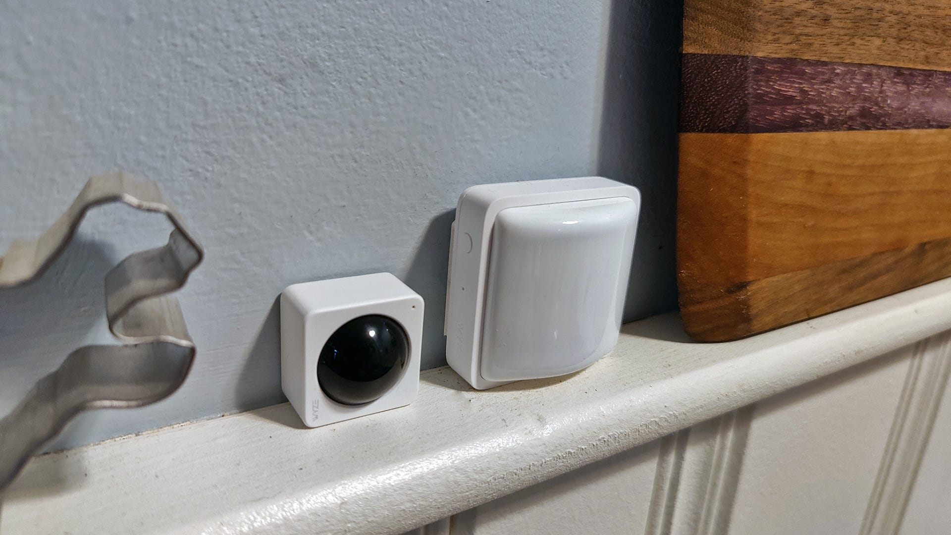 Wyze's Home Monitoring camera a motion system on a shelf.