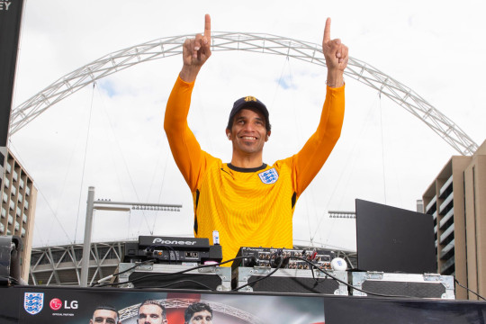EDITORIAL USE ONLY Ex-England keeper, David James hosts a silent DJ set for 33 fans to celebrate the newly announced England squad and launch of LG???s new England FA4 earbuds, outside Wembley Stadium in London. Picture date: Tuesday May 25, 2021. PA Photo. The event hosted by LG Electronics, sponsors of the England team and the FA, is in celebration of Gareth Southgate???s announcement today. Photo credit should read: David Parry/PA Wire