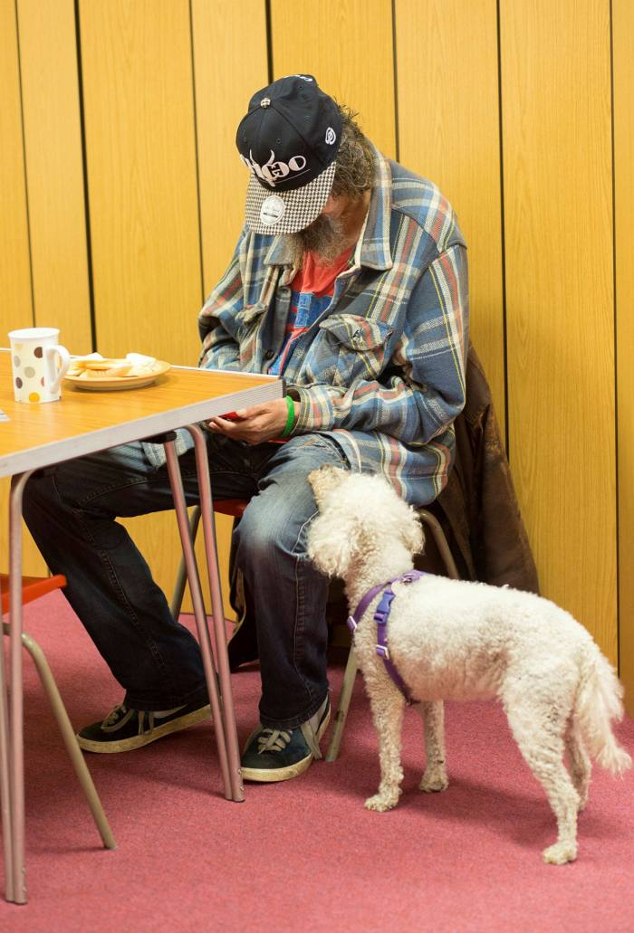 A visitor has tea at the Salvation Army in Redruth, Cornwall