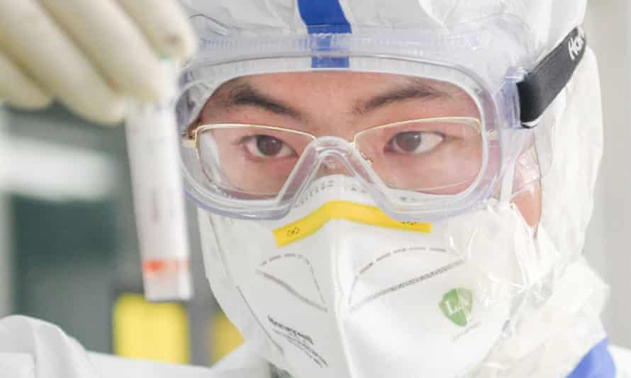 A scientist works in a virology lab in Wuhan, China.