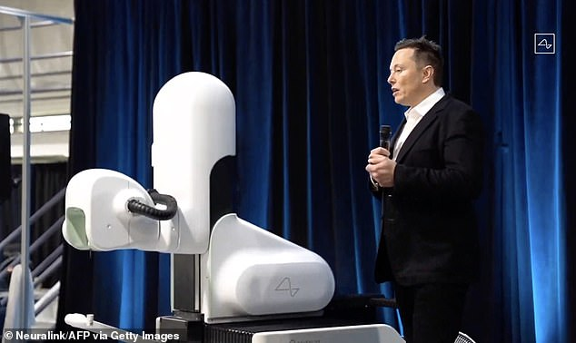 Despite Elon Musk's hype, Neuralink has yet to secure permission to try its brain-computer interface on human subjects, or even indicated it is close to this crucial step. Pictured: Musk standing next to a surgical robot during a Neuralink presentation in August 2020