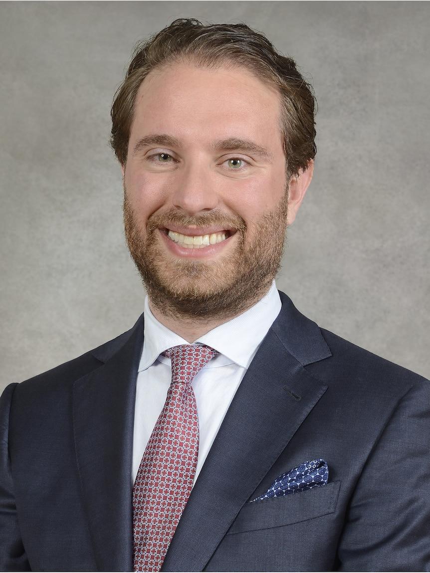 A head shot of Ryan Abbott.