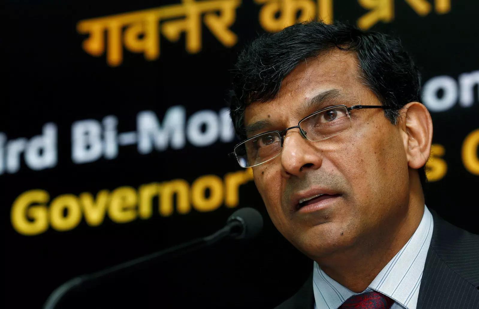 FILE PHOTO: Former Reserve Bank of India (RBI) Governor Raghuram Rajan speaks during a news conference