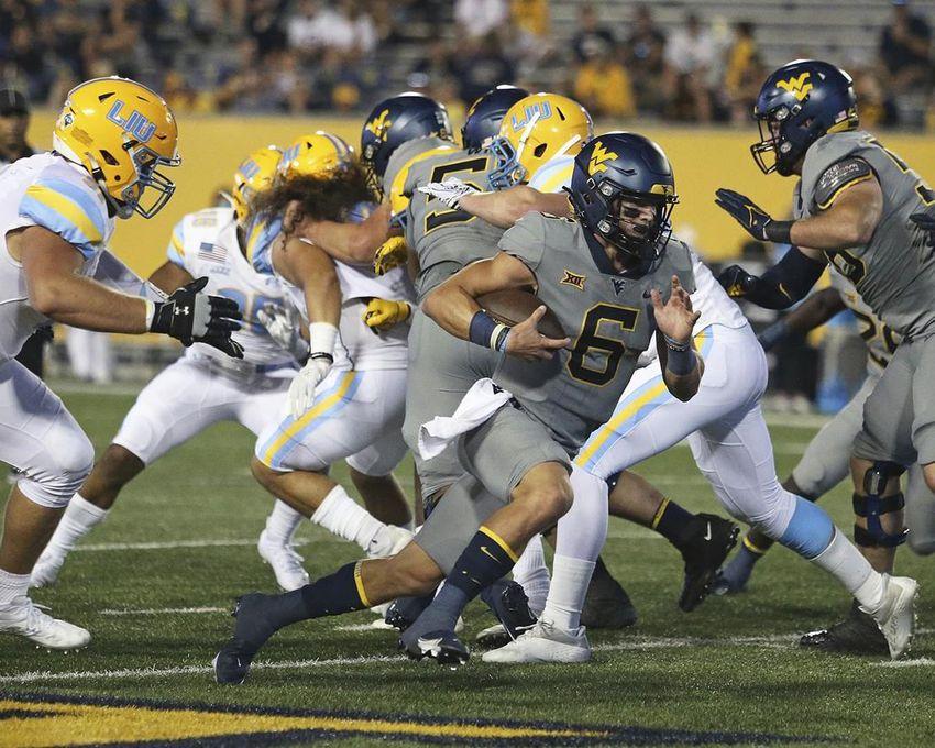 West Virginia quarterback Garrett Greene (6) runs against Long Island during the second half of an NCAA college football game in Morgantown, W.Va., Saturday, Sept., 11, 2021.