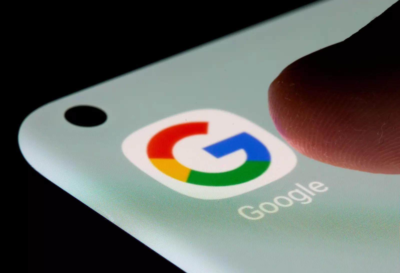 FILE PHOTO: The Google app is seen on a smartphone in this illustration