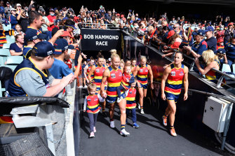 The Crows lead their team out of the race during the AFLW grand final match between the Adelaide Crows and the Brisbane Lions.
