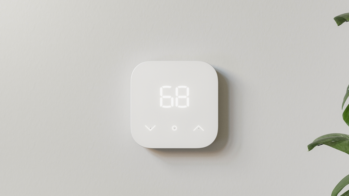 The Amazon Smart Thermostat on a blank wall.