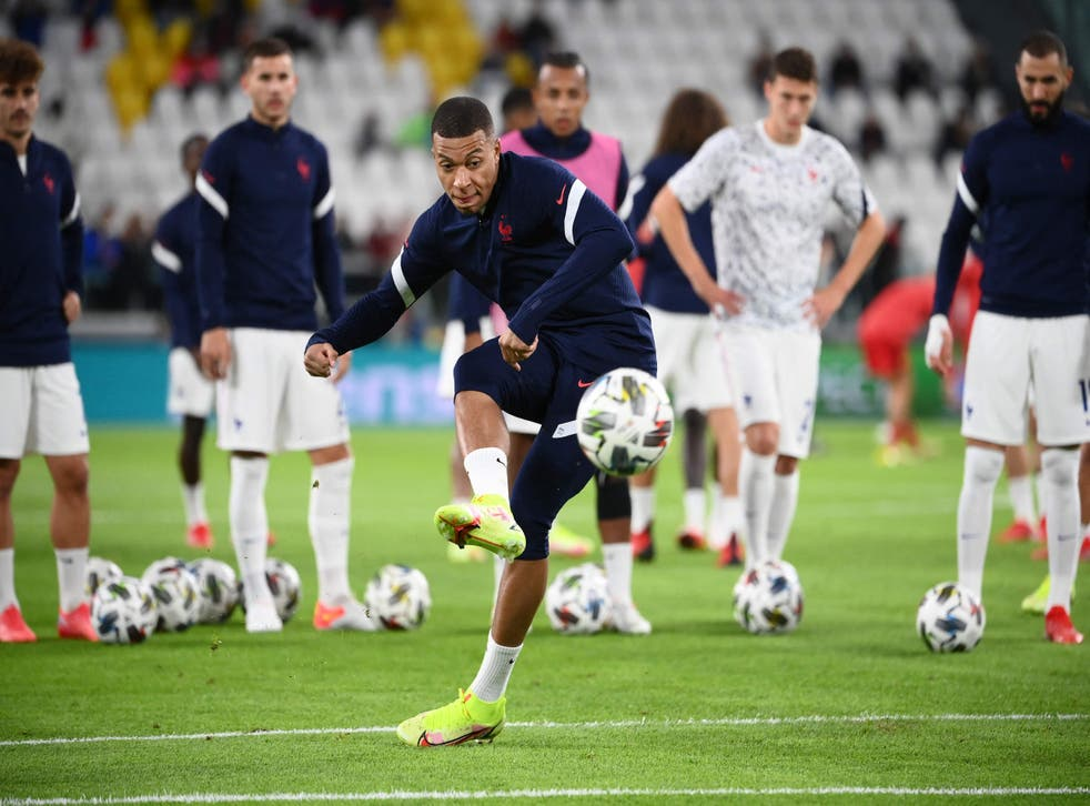 <p>Kylian Mbappe warms up before kick-off</p>