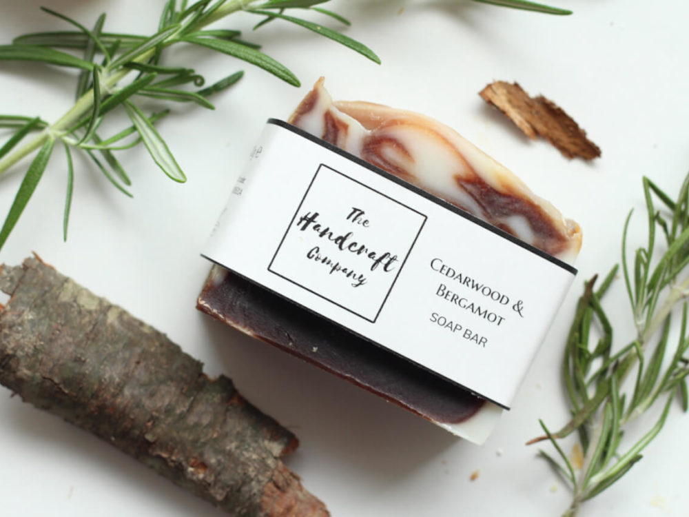 Cedarwood and Bergamot handmade soap flat lay with labels