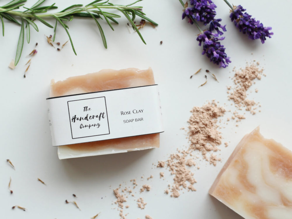 Pink Rose clay handmade soap with lavender and rosemary stem flat lay