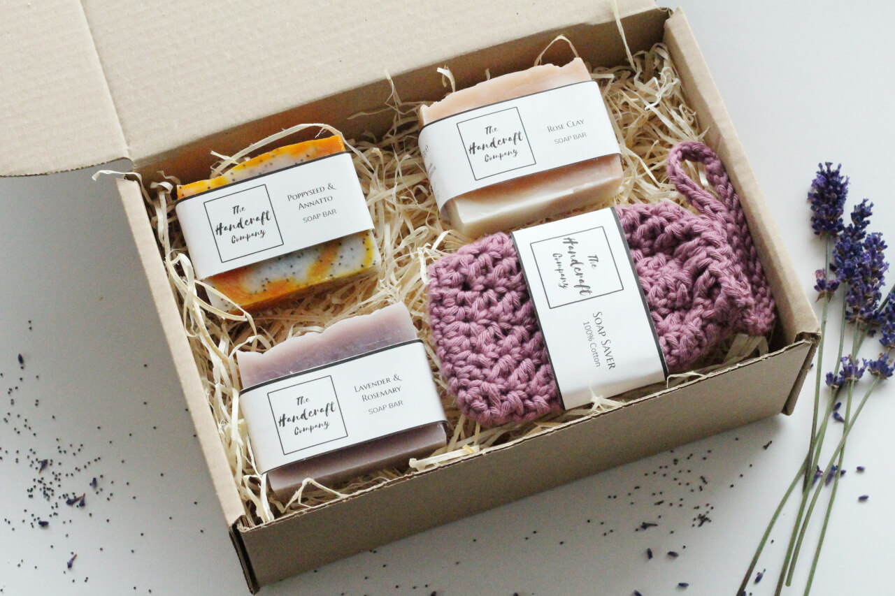 Handmade soap gift set with soap bag in a box with shredded paper rustic