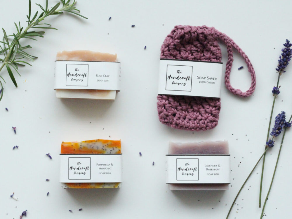 Handmade soaps with lavender poppyseed and rose clay with a pink soap bag