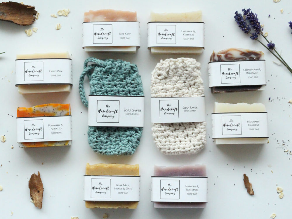 Lots of handmade soaps flat lay with two soap bags