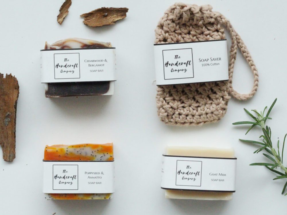 Handmade soaps for men flat lay with brown soap bag