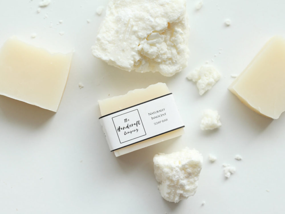 Unscented handmade natural soap with shea butter blocks flat lay