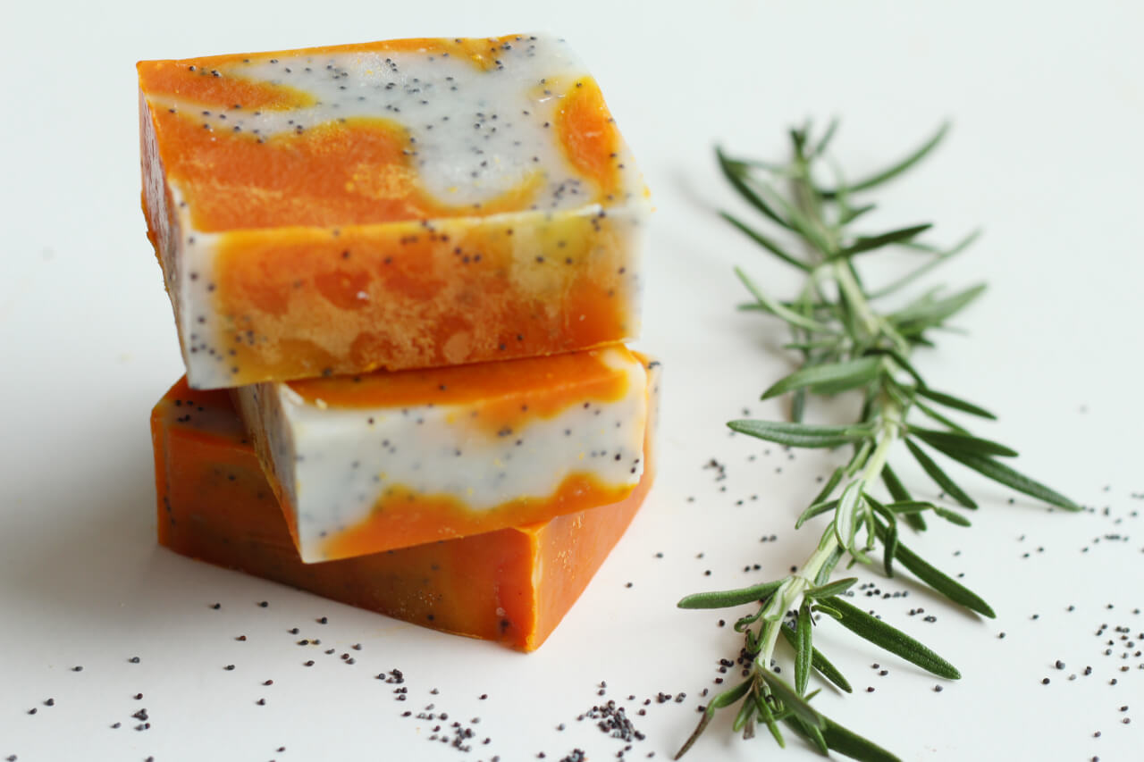 Poppy seeds and Annatto handmade natural soap with rosemary leaves