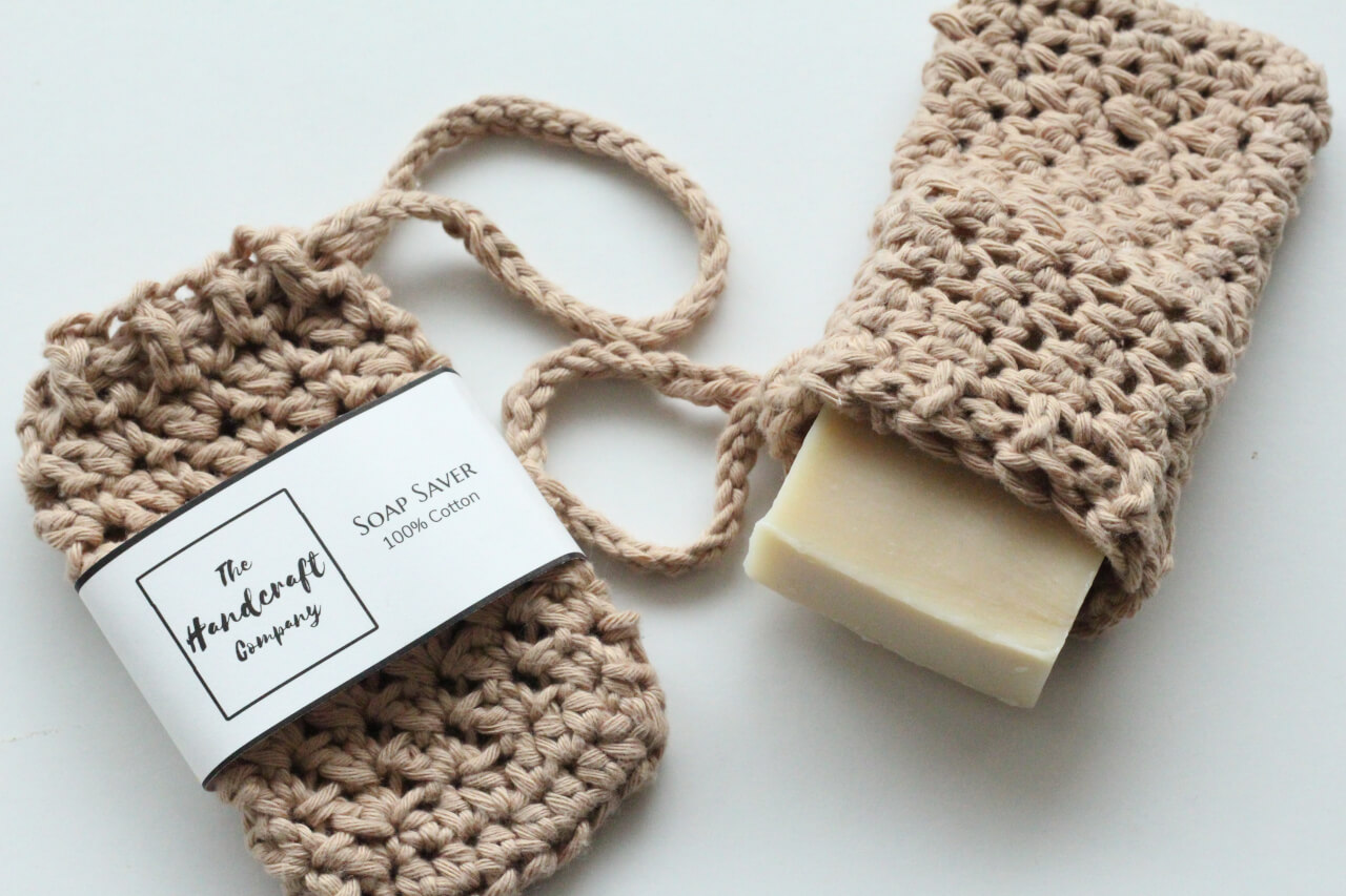 Brown soap saver handmade bag with a bar of soap