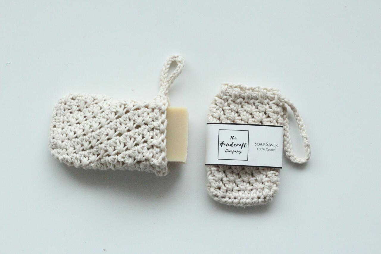 White soap saver handmade bag with a bar of soap