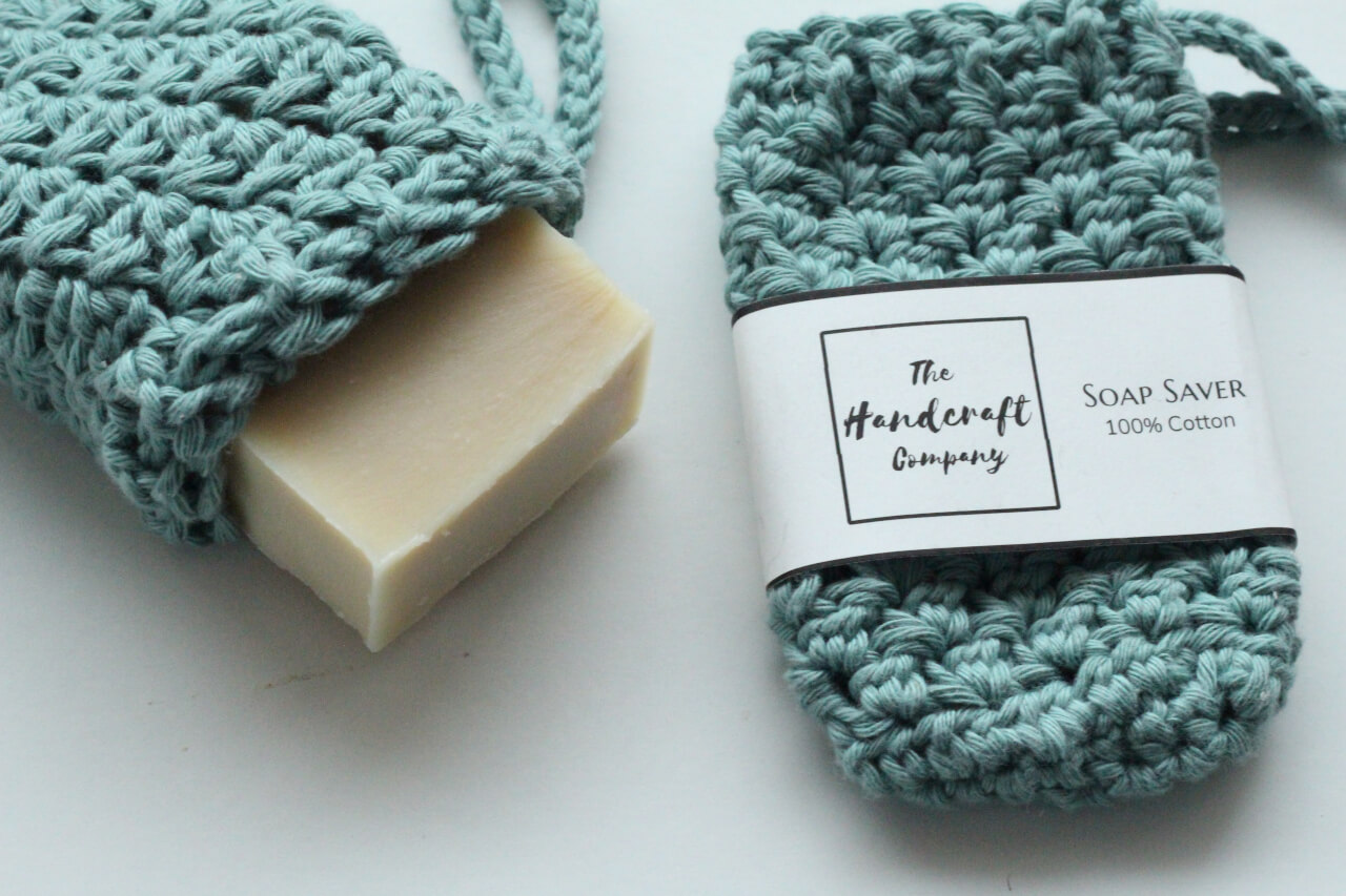 Blue soap saver handmade bag with a bar of soap