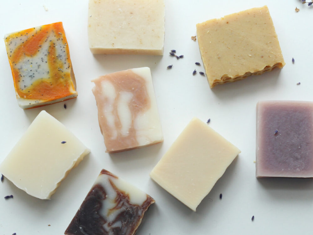 Handmade natural soaps in a flat lay