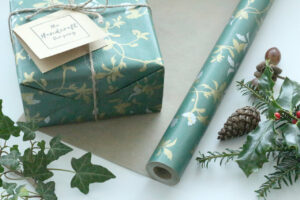 Gift wrapped with wrapping paper and acorns and holly