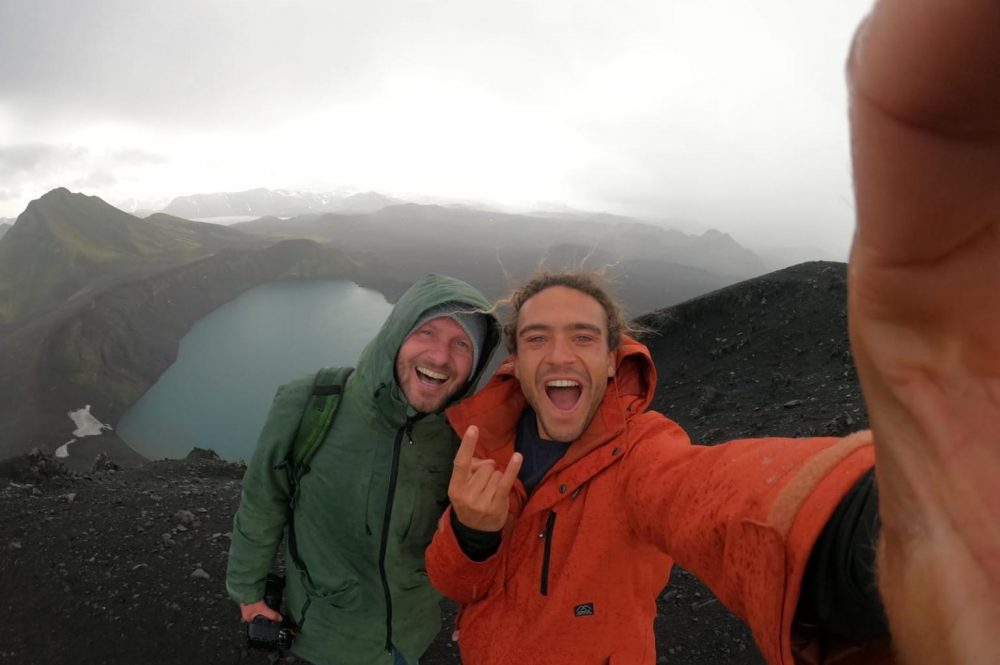 Roderick and Rein standing at the edge of a volcano