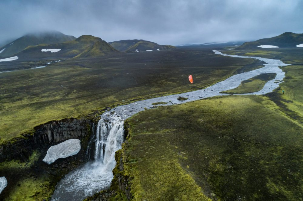 Kitesurfing from a meltwater river with Waterfall during our Last Line project in Iceland