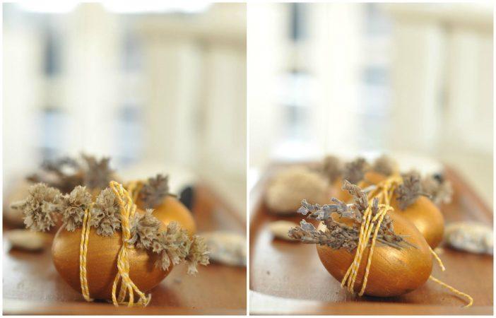 Påskeæg med guldmaling og tørrede blomsterhoveder