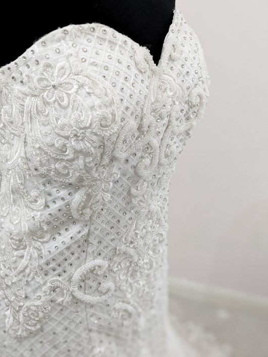 Heavily embroidered wedding dress