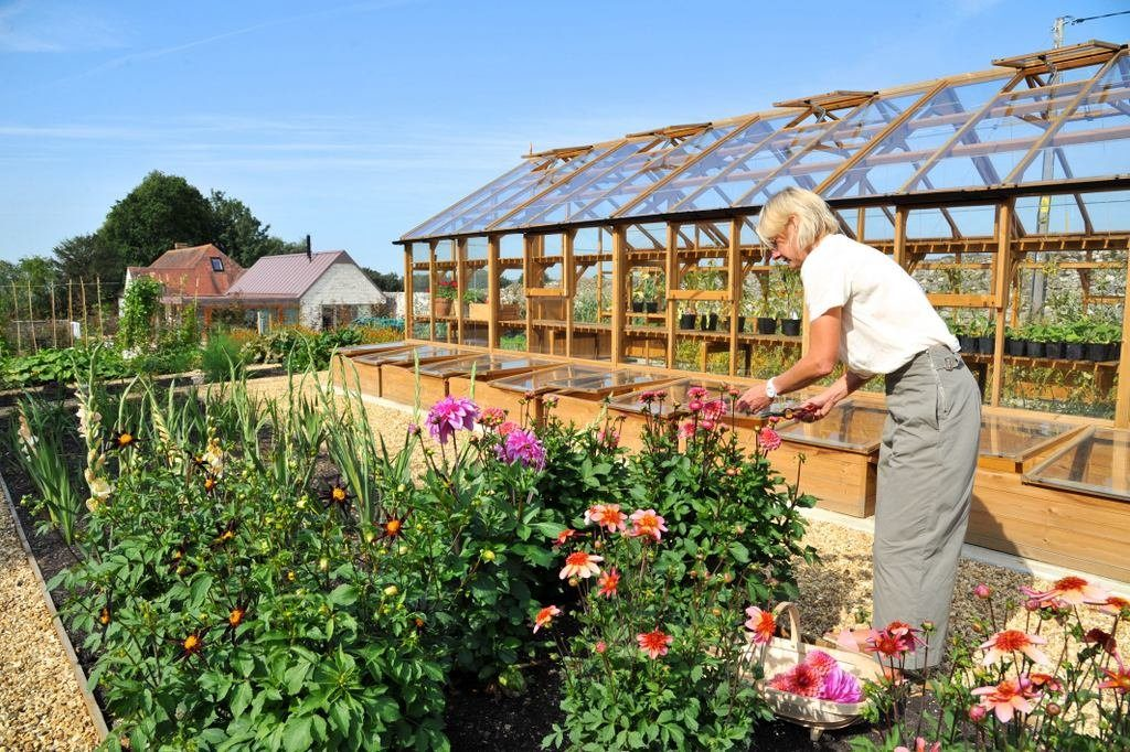 Greenhouse and flower bed planting, Long House in the background