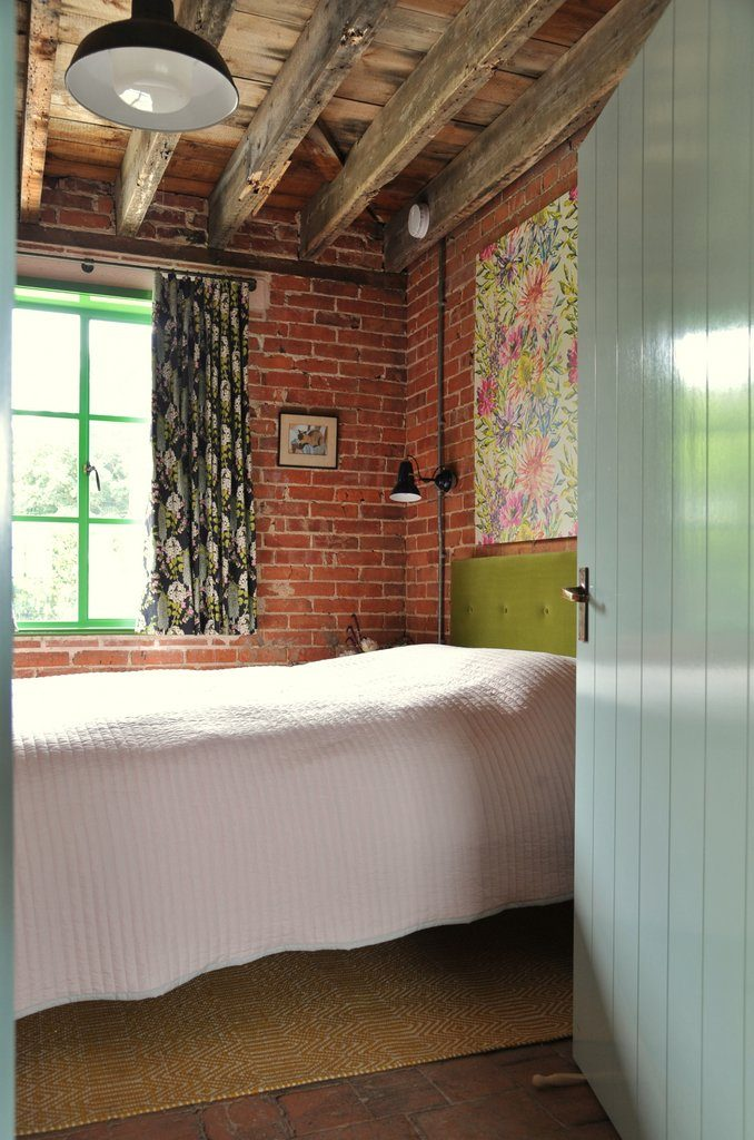 Double room with exposed brick walls, beams and quarry tiles