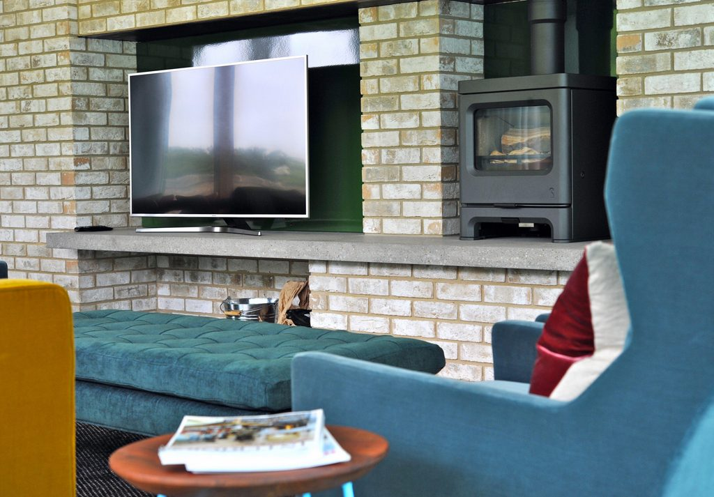 Fireplace with Charnwood Stove woodburner and large screen TV